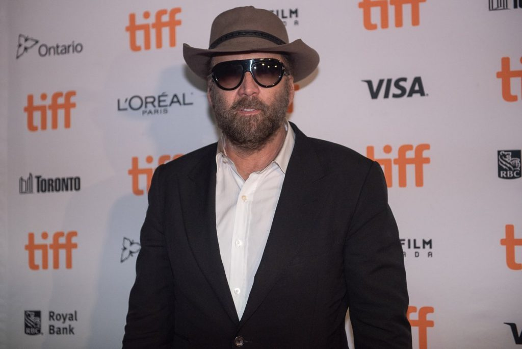 Nicolas Cage in sunglasses and a hat